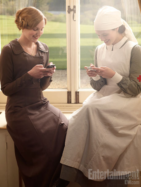 entertainmentweekly: The set of Downton isn't immune to modern technology. Holy anachronism.