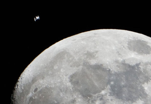 inothernews:  The International Space Station is seen as a small object in the upper left of this photo of the Moon, in the skies over the Houston area.  (Photo: Lauren Harnett / NASA via the Telegraph)