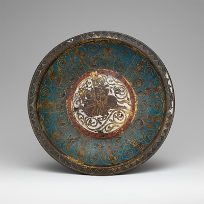 A gemellion, or hand basin, from ca. 1250-1275. It's made of copper and enamel and is decorated with a knight on horseback in the center.