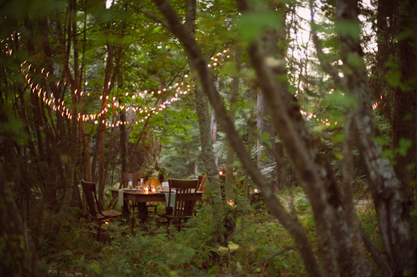 gorgeous rustic venue, i love the use of christmas lights out in the woods!