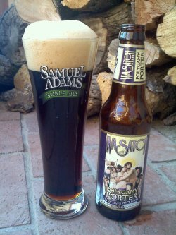 "Brew: Polygamy Porter  ""Why Have Just One!""Brewer: Wasatch Brew Pub and Brewery, Park City, UtahStyle: American PorterABV: 4.0% Okay. Okay.  … A Polygamy Porter?!  CLEARLY I purchased a six pack of this  brew within the first 7 hours of my arrival in Albuquerque. I landed at ABQ, rented my car, started to drive toward the rental  house, and promptly got distracted by a sign on the interstate for Rio  Grande Nature Center.  Anyway, after a 3-hour sidetrack at the park, I  met up with the wedding party at a yummy restaurant in Albuquerque, had  lunch and then made a trip to Sunflower Farmers Market to stock op on  food for the weekend. I, of course, promptly made my way to the back of the store to check out  the local beer selection. I… LOVE travelling out west.  One, because  there are mountains (duh), and two, because I can get all sorts of brews  (delicious, west coast brews) that I can't find in Tampa.  While  browsing the beer section (in which I, thrillingly, didn't recognize  half of the brewers), I happened upon… this.  This sweet, polygamous  nectar, straight from the Mormon capital of the world: Salt Lake City,  Utah.  Which would explain, as a porter, it is only 4.0% ABV  (apparently, no beer in Utah can be brewed above this percentage). My decision was swift and certain.  Why would I NOT purchase this  beer?!  First and foremost, it is called Polygamy Porter.  Um, not short  of brilliant.  And secondly, IT IS BREWED IN DAMN UTAH FOR CHRISSAKE! But really.  Let's get down to biznaz. Upon opening this brew, I saw that it poured a nice, deep brown, that  displayed a beautiful garnet shine in the middle of the beer when I held  it up to the porch window and let the last rays of the desert sun  penetrate the glass. And pleasingly, the beer in the corners of the  pilsner glinted with a nut-brown color.  I have never seen such an  interesting color combination in a beer before — and in a porter, of  all things!  And the head of the beer is amazing!  I mean, just look at the picture.  At least two inches of light, fluffy, chocolatey cotton candy. And, as I  drink it, it has left a really romantic ecru lacing around the inside  of my glass — reminiscent of the aerial view of the brambles of pinyon  pine scattered across the dusty desert landscape that I observed as I  landed in the city early this morning. The smell is really quite delicious. Dark malts, chocolate (milk, not  dark), and caramel. Standard delicious combination of smells for a  porter.  One review said it smelled faintly of tobacco, and upon further  sniffing, I find that I agree. As for the taste — it is, to be fair, nothing to sing about.  It is a  porter, certainly, but all the normal porter characteristics that you  might have are simply subdued and kind of leave you wishing for a  richer, deeper, more complex taste. That being said — it is not a bad  beer! It is a tasty porter. Just not inspiring.  There are burnt notes  in the taste, and some nice caramel. The mouthfeel is also uninspiring, sadly.  Again, not bad! But a bit watery. I'd likes some chewiness or more carbonation.  The Polygamy Porter, overall, is actually a very drinkable beer. I mean,  it is a 4.0% ABV brew! It's a really light porter; the water used to  make it is clearly crisp and clean. That, in combination with its low  ABV, make it an excellent brew for first-time porter drinkers who need  to start easy. …Really, why have just one? Cheers!  To love.  All love. xo, Mary"
