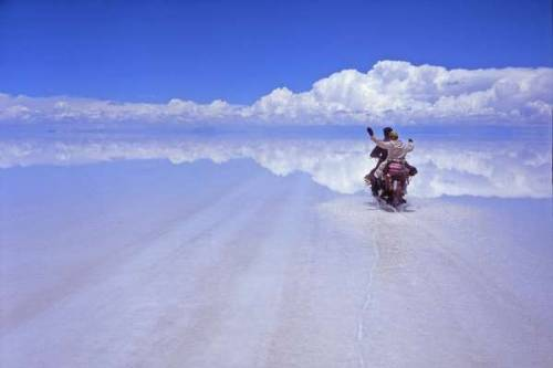 Riding on clouds by Alessio Corradini. At Salar de Uyuni, the largest salt flats in the world. 4,086 square miles located in Bolivia.
