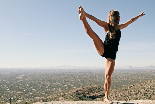 healthymeansbeautiful:  How to improve flexibility in your legs (Because, who wouldn't want to be able to do that!?) Increasing flexibility requires that you hold your stretches for extended periods of time. This means that you must select exercises that allow you to adopt a stretched position and maintain it without undue stress or discomfort. To improve your flexibility, you should hold your stretches for at least 30 seconds, but be prepared to hold positions for up to three minutes to maximally develop your leg flexibility. Always warm up before stretching to minimize your risk of injury. Supine Hamstring Stretch To perform the supine hamstring stretch, you need a hand towel or 4-foot long piece of rope. Sit on the floor and loop your towel around your left foot. Lie back on the floor and extend your left foot up towards the ceiling while keeping your right foot on the floor. Gently pull your left leg towards you by pulling on the towel. Keep your shoulders relaxed as you try to increase the stretch on your hamstring muscles. Once you have held the stretched position for the desired duration, slowly return your left leg to the floor and perform the exercise on your other side.      Supine Inner Thigh Stretch      The supine inner thigh stretch uses gravity to gently increase your flexibility. Sit sideways onto a wall with your legs bent and feet flat on the floor. Lie back onto the floor and simultaneously swing your legs up so that they are resting against the wall and your body is perpendicular to the wall. From this position, slide your feet out and down to create a V shape with your legs. Relax your inner thighs and allow your legs to spread further apart. Hold this position for the desired duration before rolling both legs to one side and slowly standing up. Prone Quadriceps Stretch To stretch your quadriceps — the muscles on the front of your thigh — lie on your stomach with your legs straight and your hands beneath your forehead. Bend your left leg and reach back with your left hand to grasp your foot. Gently pull your foot in towards your butt. Only pull your foot as close to your butt as your knee health allows. Hold this position for the desired duration and then carefully swap legs. Standing Calf Stretch The standing calf stretch uses gravity to increase the flexibility in your lower leg muscles. Stand on the edge of a step so that the balls of your feet are on the step and your heels are in free space. Use your arms for balance and hold on to a nearby wall or other support. Slowly lower your heels as far below the edge of the step as possible. Try to relax and gradually increase the depth of the stretch. Hold for the desired duration and then carefully dismount the step.