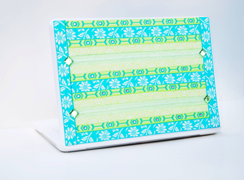 Blue Green Jewel Stickybun Laptop Skin from Rapt! There are only two available!6.75″X9.75″ @ 19.50 The StickyBun is a 3-Dimensional look that is much more visually exciting than a skin but still maintains a thin, lightweight protective cover that is applied directly to a laptop. This StickyBun is a Limited Edition, which means that there are very limited quantities of each, between one and three. This LE StickyBun was crafted with the intention of being reproduced but found to be too time consuming and/or expensive to make on a larger scale. On the back there are thin strips of adhesive along the edges and adhesive dots in the middle. The adhesive stays very well, but be can taken off at any point. The StickyBun can be removed by simply peeling off the StickyBun and rolling off any leftover gel with your fingertips. This StickyBun is extremely durable and its lifespan is about a year. It protects laptops from nicks and scratches while personalizing your laptop. Each StickyBun is unique and handmade in the United States. Click on the photo to be directed to the Rapt website! Follow us on twitter: @All_Rapt_Up