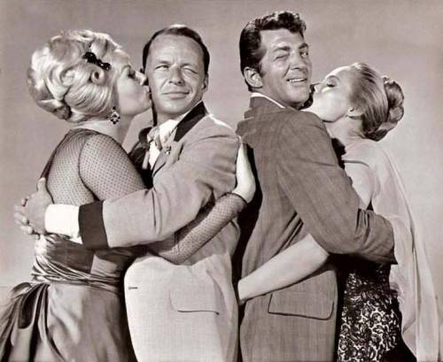 theswingingsixties:  Anita Ekberg, Frank Sinatra, Dean Martin, and Ursula Andress snuggle up in '4 for Texas', 1963.