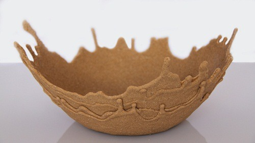 executions:  Sand Bowl by Leetal RvlinTel-aviv-based industrial design student Leetal Rivlin has captured the movement of sand and frozen it into a usable object. The bowl is hand-made by mixing the grains of sand with an adhesive. The viscous liquid is then allowed to drip and harden into the form of the container. Various layers give the impression of preserved movement.