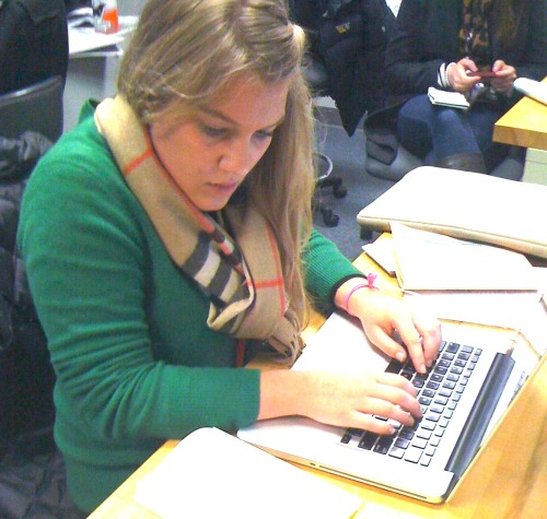 Grad student Elaura Rifkin works in The Concord Monitor newsroom after interviewing voters on Tuesday in the nation's first primary in New Hampshire. Mitt Romney finished first, and Ron Paul came in second.