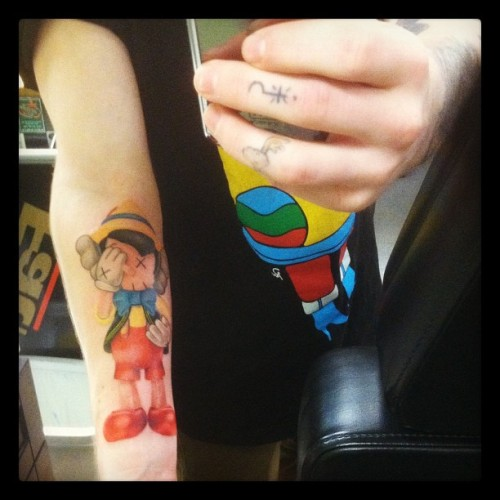 Kaws x Pinocchio! done at Wayne's Tattoo World, Hudson, NH