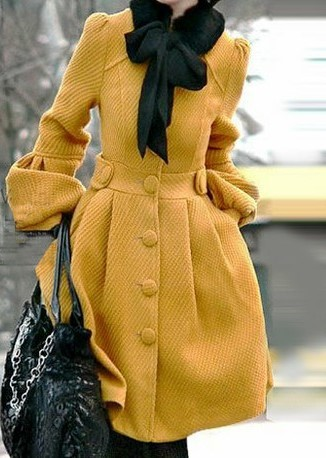yellow coat with a bow