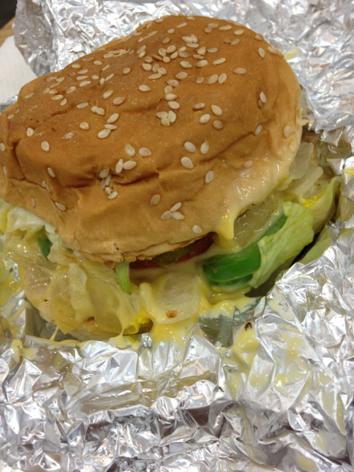 Five Guys: First Impression Pros: - Nice and clean - they have a vegetarian sandwich (pictured: bun filled with the toppings of your choice. I chose sautéed onions, pickles, peppers, cheese, lettuce, tomatoes, mayo, mustard) - no awful veggie burgers - hand-cut fries (pretty good, but they are a bit dense/heavy and I like my fries crispier. Mine were also under salted, but that likely varies from batch to batch) - malt vinegar available for fries - they do not cook meat and veggies on the same grill - openly state on their website that their meat is neither organic nor grass fed (I appreciate transparency) - good lettuce (not shredded from a bag) - they have a choice of plain onions and sautéed onions - no charge for toppings Con: the free peanuts are awful. Would like to see: - cheese fries with onions/toppings on the menu - more than one kind of cheese (they only have American), like cheddar - fresher/better (read: more flavorful) quality tomatoes and peppers - a grass fed beef option Overall, my veggie sandwich was reasonably priced at 3.29, the staff was courteous, and I enjoyed my food. Portions are generous. My sandwich was also neatly assembled, which made it easy to eat. I will be coming again any time I need a quick fix (and to try their grilled cheese), but I probably won't bother with the fries in subsequent visits. Yums: ✭✭✭✰
