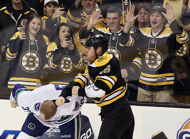 Bruins fans get a front-row seat for the first period brawl between Nathan Horton and Dale Weise during Saturday's Stanley Cup rematch between Boston and Vancouver. The Canucks won a penalty-filled game, 4-3. (Elsa/Getty Images) POWER RANKINGS: Find out where the Bruins and Canucks rankGALLERY POLL: Weigh in with your vote on fighting in hockey