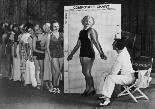colettesaintyves:  Busby Berkeley and some of his chorus girls - c. 1930s