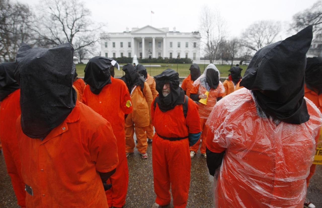 Protesters mark Guantanamo prison's 10th anniversary Human rights protesters dressed in orange prison-style jumpsuits and covering their heads with black bags marched past the White House on Wednesday to mark the 10th anniversary of the U.S. military detention camp at Guantanamo Bay, Cuba.