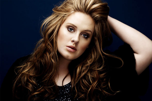"ADELE'S ""21"" album hangs in for a whopping 15th week at No. 1 on the Billboard 200 chart, selling 124,000 copies according to Nielsen SoundScan (down 14%). It's the only title to move over 100,000 this week, as the No. 2 set — DRAKE'S ""Take Care"" — shifts 42,000 (down 41%). The last album to spend more weeks at No. 1 was the soundtrack to ""Titanic,"" which claimed 16 frames atop the list in 1998. Considering the scant number of albums that were released this week, ""21"" will likely nab a sweet 16th week at No. 1. Read More at Billboard.com The fact that this chick is still selling that many albums in a week WELL after it's initial release date speaks VOLUMES! I have faith!!  xxoo @RozOonTheGo"
