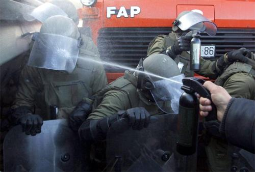 occupyonline:  teknopolitik:  From Serbia  Did you guys drop one of your cans? That's why bringing weapons to party is dangerous. Side note: I'm sorry but the 12 year old boy in me can't stop reading FAP.
