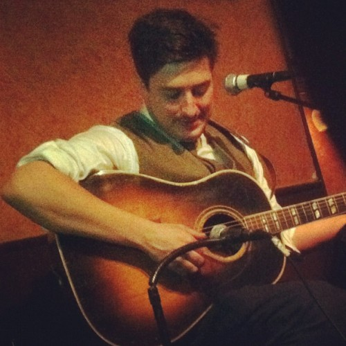 Marcus Mumford of Mumford & Sons performs an impromptu set at Caffe Vivaldi in NYC's West Village on Tuesday, January 10, 2012. Photo courtesy of esmatteo.