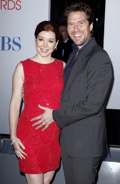 fuckyeahjosswhedon:  Alyson Hannigan and husband Alexis Denisof arrive at the 2012 People's Choice Awards in Los Angeles January 11, 2012