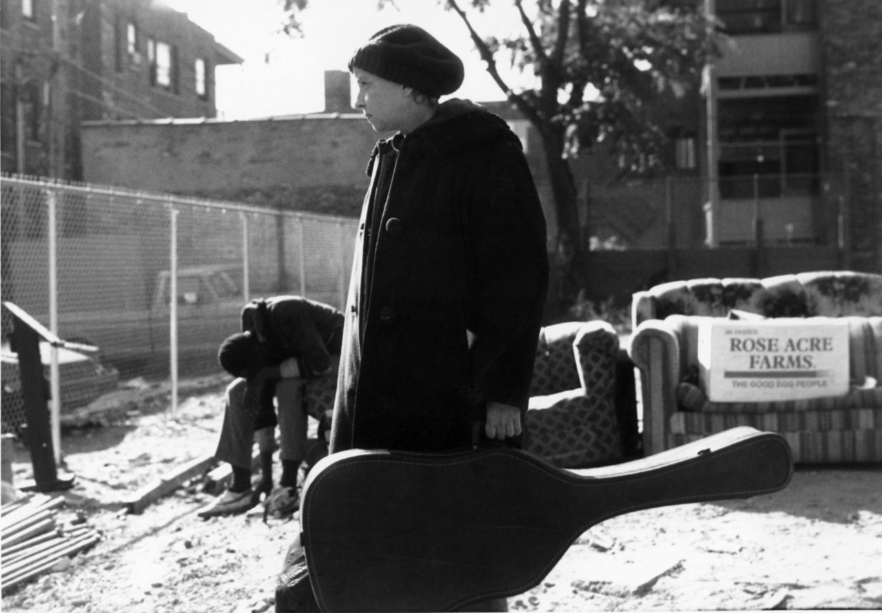 Homeless Woman at Tent City with Guitar - 1988 -, Uptown, Chicago, IL
