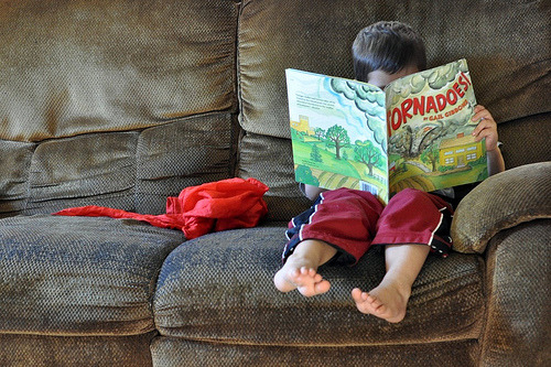 teachingliteracy:  (by nineminutes)  YAY kid reading! But I have to say it's the baby feet that make me really swoon.
