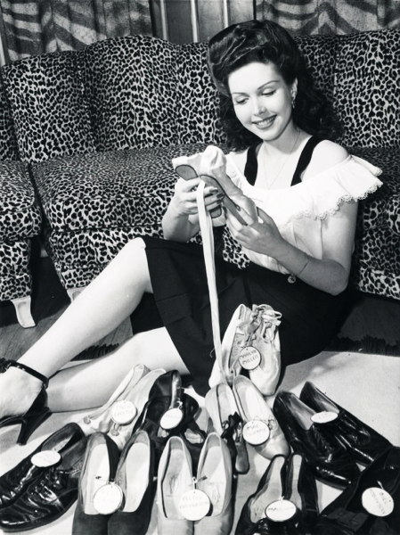 Ann Miller and her collection of famous dancers shoes. (1944) Among famous names on her shoe collection are Nijinsky, Pavlova, Irene Castle, Rita Hayworth, Fred Astaire, Gilda Gray and Mae Murray.
