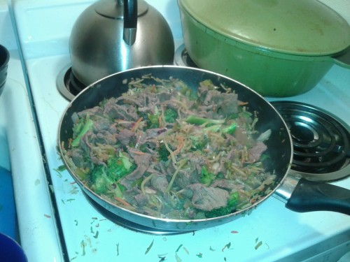 Stir-fry There are a lot of way to start of an Americanized Asian week that are cheap. Things such as frozen Orange Chicken mixes are now common place in every grocery store, but nothing quite takes the cake like a great stir-fry. It's really simple, just toss in a pan and you're done. Well, maybe not that simple, but close. I enjoy the straight forward method of stir frys. I started out with some left-overs that I had from last week. Broccoli Slaw - $1's worth left Chicken stock - One cup's worth I tossed the slaw in the pan with some garlic and ginger (the real stuff please). I tossed in some florets of broccoli and diced green pepper as well. After that, I added a 6 oz mixture of soy sauce with notes vinegar and sriracha for balance and tossed in the stick stock. After the liquid went down by 1/2. I tossed in the 3/4 pound of sliced round sirloin (surprisingly $5/lb) marinated in soy, ginger, and sriracha.  Then, once it's done it's done. It's fine plain or over rice. Estimated Total Cost: $8Estimated Meals: 3Cost per Meal: $2.67