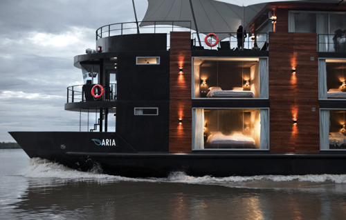 The M/V Aria is a tour boat/hotel that lets you tour the Amazon river from the comfort of a snuggly bed.