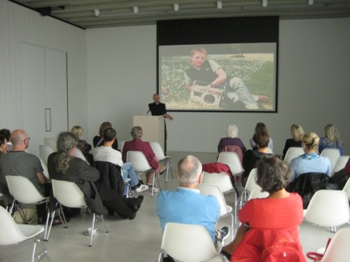 Me giving a talk about my photos and work at Turner Contemporary, Margate. Here I am explaining the short-lived fashion for skinheads (mainly skinhead girls) to wear moccasins. Picture circa 1981.