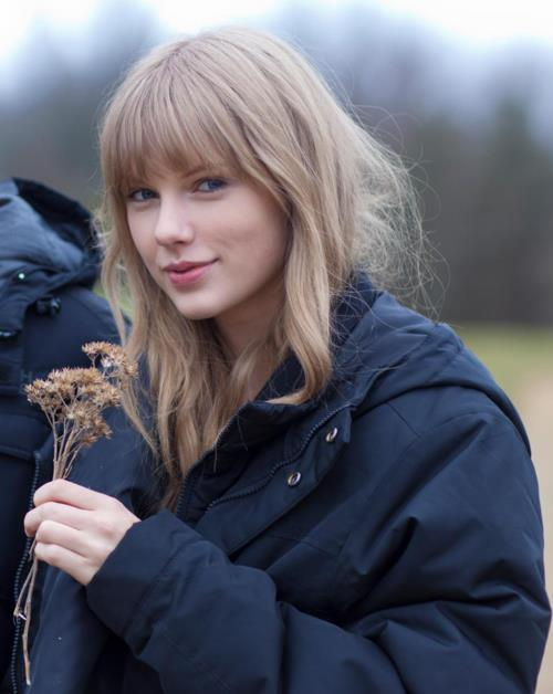 Taylor Swift on the set of Safe and Sound Music Video Shoot whenpagesturn:  Taylor Swift on the set of Safe and Sound music video shoot. YOU GUYS! DO YOU SEE WHAT SHE IS HOLDING? DO YOU? OMG.