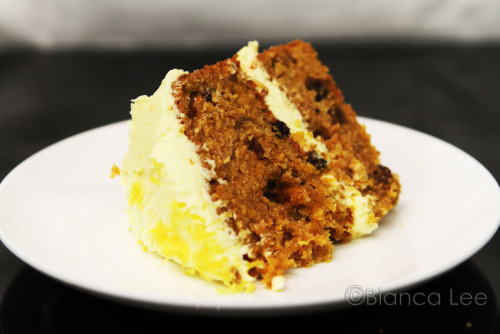 Recipe - Carrot Cake  recipe makes 2 6 in cakes and cupcakes 1/2c nuts of your choice 2/3c mixed dried fruits +raisins 3c grated carrots 1 3/4c flour 1 tsp baking soda 1 1/2 tsp baking powder 1 1/2 tsp cinnamon 3 egg 1c sugar 3/4c oil 1tsp vavnilla Cream Cheese Frosting: 57g butter softened 227g cream cheese softned 1/2cup icing sugar sifted 2tsp lemon juice 2 tbsp lemon zest 180C. Peel and grate carrots.  Beat eggs until frothy, add sugar, beat. Add oil beat. Beat in vanilla. Sift in dry ingredients, mix. Fold in grated carrots, nuts, dried fruits. Bake for 25-30minutes. Cool Frosting: Beat butter and cream cheese until smooth, sift in icing sugar. Mix in zest and juice. Spread on one layer of cooled cake. Top with other cooled cake. Spreadfrosting on top.  Via - bakingexplosion http://www.flickr.com/photos/bakingexplosion/6666631529/in/photostream