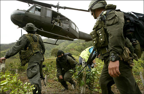 "The Once and Future Drug War Since Mexico's President Felipe Calderon began a war on drug gangs in 2006, nearly fifty thousand people have been killed in drug related violence. Writing for The Washington Monthly, Elizabeth Dickinson examines the state of the drug war in Colombia, a war whose alleged success pointed the way for Mexico:  In Medellín, I met a middle-aged woman named Doli Posada who described this new landscape. ""There are so many people who are afraid to leave their neighborhoods these days,"" she told me, referring to the barrios that creep up from the mountainous city's high line. In the community where she lives, her neighbors are being asked, once again, to pay armed groups taxes to provide ""security."" After a few brief years of calm, today they feel anything but safe. According to many accounts, violence in the barrios took off when Medellín's once dominant crime boss, a former paramilitary known as ""Don Berna"" (his real name was Diego Fernando Murillo Bejarano)—was extradited to the U.S. in 2008. After Uribe's military had beaten back FARC, Don Berna had been able to solidify his control over the city and pacify it. Now that he's gone, new, smaller gangs have sprung up to fight over who gets to fill the vacuum. ""By seriously crippling the competing guerrillas, the government had given a monopoly to Don Berna,"" wrote Francis Fukuyama and Seth Colby in a recent article in Foreign Policy magazine. ""It was peace achieved through market dominance, not demilitarization."" And the problems are not just in Medellín. An hour's flight from Bogota, on the Pacific coast, the town of Buenaventura is reeling. During the height of summer, gangs held frequent gun battles to control several of the barrios that have access to the ocean in this seaside port town—the knotted creeks of the coastline are perfect for getting cocaine out of the country fast. In the licit markets too, prices here are much higher than in even the posh areas of Bogota, and the armed gangs control every market, from cocaine all the way to eggs, milk, and ripe plantains.   Read the full article here."