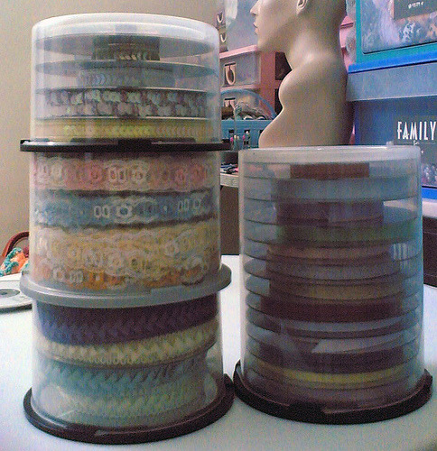storagegeek:  DVD Cases to Ribbon Storage Recycled, dust and tangle free ribbon storage. I do not know the original source of the photo, but I did link to the post where I found it. Also, if you do know the source please let me know!  Gosh, this is a great idea. *_*