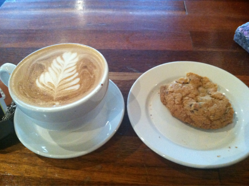 cafeaulaittt:  Mmmm large dirty chai and a chocolate chip cookie, perfect way to start Winter Term :)  Slow Train's got new shelves behind the counter, too! They can hold even more coffee, tea, and delicious beverages than before.