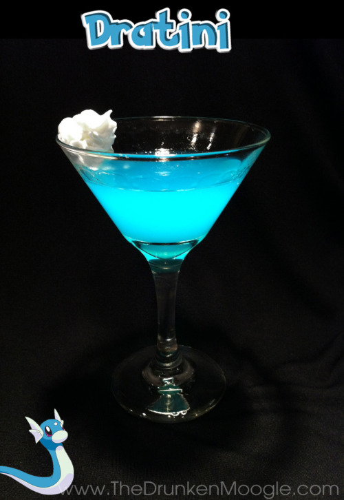 "thedrunkenmoogle:  Dratini (Pokemon cocktail) Ingredients:1 1/2 oz gin (Bombay Sapphire Gin used)1 1/2 oz Hpnotiqsplash of blue curacao Directions: For this variation of martini, mix and stir in the ingredients over ice, then strain into a chilled cocktail glass. Place a dollop of whipped cream on the side of the glass as a garnish. ""It is called the ""Mirage Pokémon"" because so few have seen it."" -Pokedex entry for Dratini  Drink created and photographed by The Drunken Moogle."