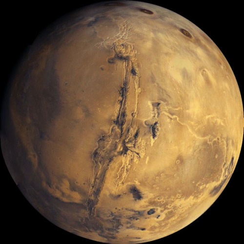"it is often described as the ""red planet"" as the iron oxide prevalent on its surface gives it a reddish appearance."