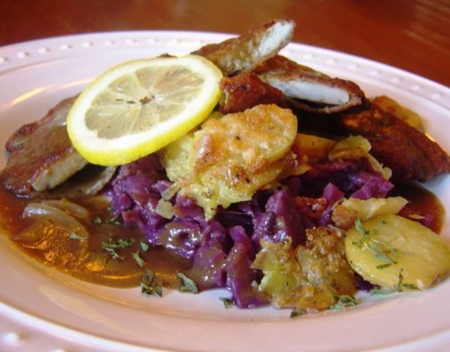 Schnitzel with German roasted potatoes and stewed rotkohl and apples. Submitted by:  http://chucksfoodpics.tumblr.com/