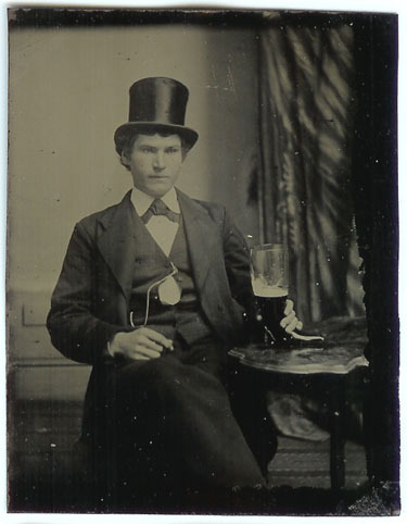 ca. 1860-1890, [tintype of a gentleman in a top hat with a high heel, boot-shaped glass of beer] via Remains to Be Seen Gallery