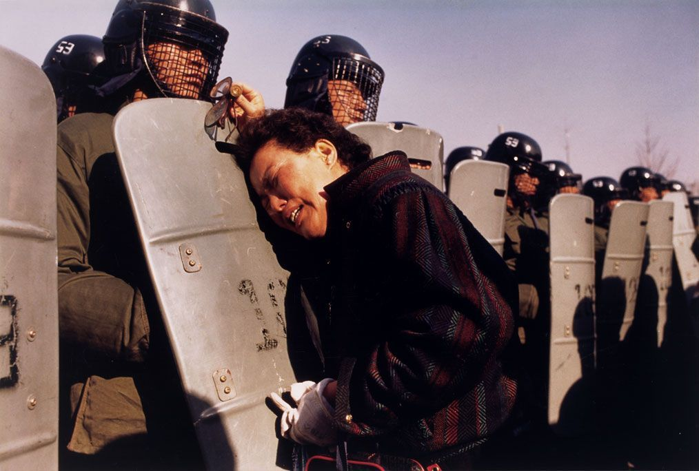 politics-war:  South Korea, 18 December 1987. A mother pleads with the riot police after her son was arrested at a demonstration accusing the government of fraud in the presidential election.