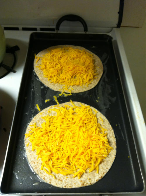 Step 2 - griddle the fuck outta some whole wheat wrap and cheese ( put sautéed veggies on the cheese )