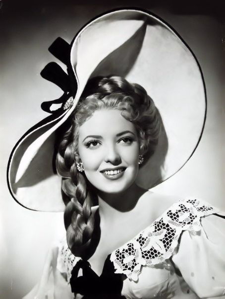Linda Darnell (Oct. 1923 - April 1965) (photo found on flickr before edit) Made her 1st film Hotel For Women in 1939 at age 15 posing as 17 and listed by 20th Century Fox as 19. Unable to have children adopted a little girl with her first husband. Tragically died at age 41 from burns sustained in a house fire covering 90% of her body.  Sadly, Linda could have survived.  She went downstairs to retrieve a large sum of cash and didn't jump from a 2nd story window as the other occupants had.