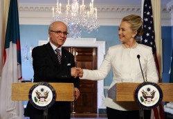apsies:  Secretary of State Hillary Clinton shakes hands with Algerian Foreign Minister Mourad Medelci during a press conference following their meeting at the State Department on January 12, 2012.  Secretary of State Hillary Clinton AND HER HAIR shake hands with Algerian Foreign  Minister Mourad Medelci during a press conference following their  meeting at the State Department on January 12, 2012.