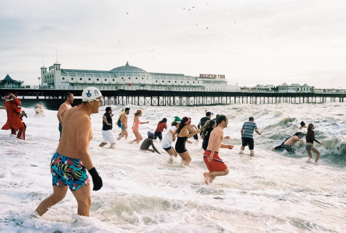 Brighton Christmas day swim 2011 by lomokev Specks at the top of the photos are sea gulls not dust in case you where wondering. Check out my best christmas day swim photo from 2011, possible all the christmas days combined here. Check out photos form previous christmas day swims in this blog post.