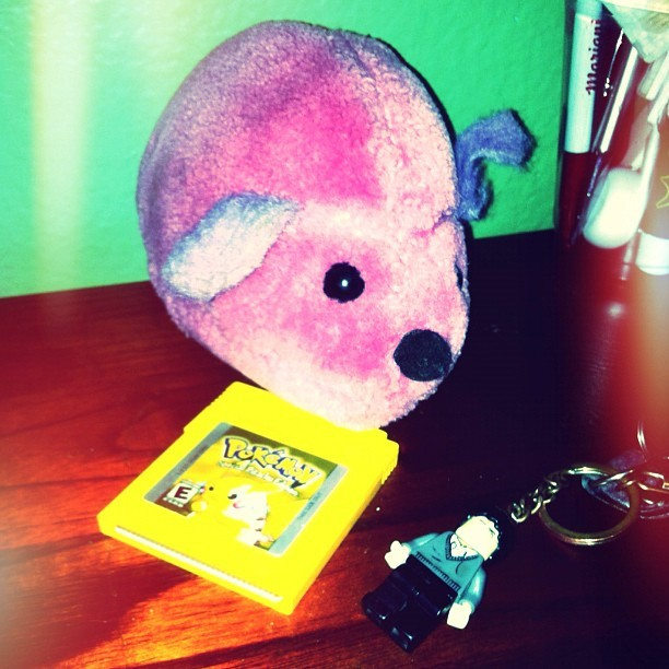 #day #ten- your #childhood. These three #things are from my childhood. The #pink #mouse #plushie is from my #cousin in #portugal. I would always play with it each time we would visit. Obviously I played #pokemon #yellow, i love #pikachu. And lastly the #harry #potter #keychain represents the #book #series I read as a kid. #pokemonyellow #dayten #photoaday #photo #challenge #personal #mine #sentimental #memories #instagram (Taken with instagram)