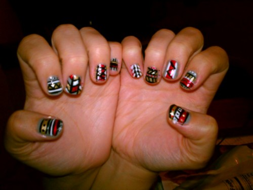 Tribal nails that I (amber) just did on my friend :) colors used: Sidewalkers - NYC Under 18 - Sinful Colors Gold - Sally Hansen Salon Black - Kiss Nail Art Paint
