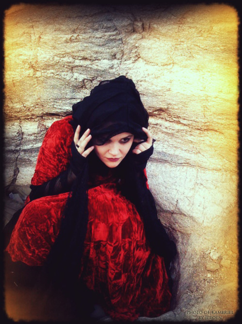 Photo of Kambriel (wearing the red velvet Suspiria Gown: http://www.kambriel.com/redsuspiria.html & Black Femininja Cowl: http://www.kambriel.com/hood-ruffle.html) taken by Jeroen Medema in the desert surrounding Tucson, Arizona.  It was November and 90 degrees in the shade, with snakes slithering by…