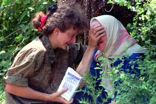 picturesofwar:  In a July 13, 1995, an unidentified woman and her mother, refugees from Srebrenica, cry together at a UN base north of Sarajevo because they don't know what happened to the rest of their family.(Darko Bandic/Associated Press)