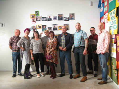 Opening night at the Turner Contemporary, 16 September 2011. Participants in the project pose in front of their portraits in the gallery. Former and current punks and skins (and a goth) from Margate and the surrounding area. Photo © Gita Malhotra.