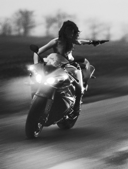 Slightly NSFW- girl in a gunfight on a sportbike