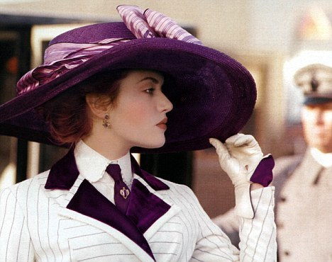 Titanic - Kate Winslet as Rose, wearing a white pinstriped suit with purple details. Tie, hat and the glove lining were purple, too.