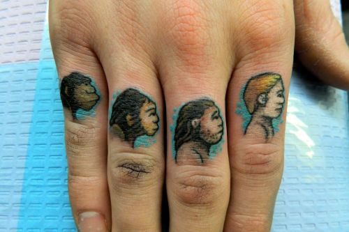 fuckyeahhandtattoos:  Evolution knuckle tats by Scott Kalina at The Sunken Ship Tattoo - LaSalle, IL www.facebook.com/thesunkenship