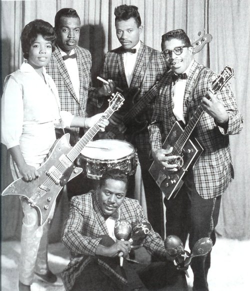"Bo Diddley and his band in the early 1960's Norma Jean ""The Duchess"" Wofford, Frank Kirkland, Jesse James Johnson, Bo and sitting on the floor, Jerome Green"